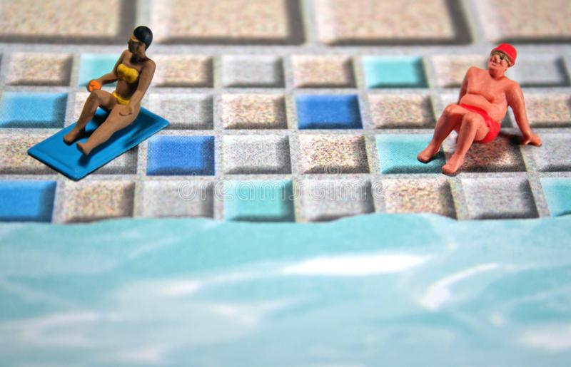 Woman and man sunbathing royalty free stock images