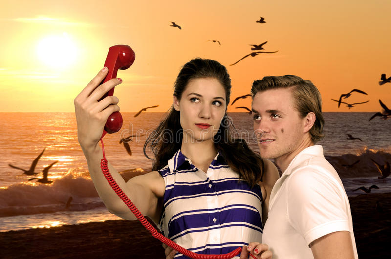 Woman and man taking a selfie stock photography