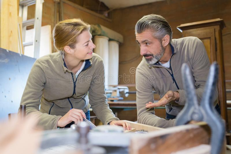 Woman and man wooden working royalty free stock photography