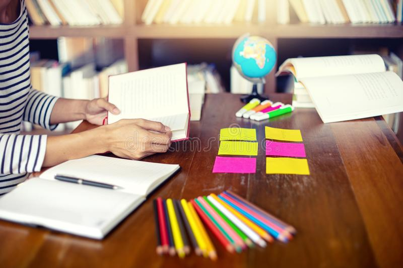 Woman and man work for education or business on the table. With notebook laptop and paper work color pen, in the libary room stock image