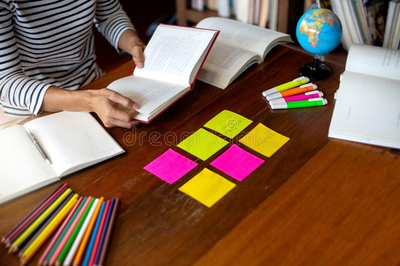 Woman and man work for education or business on the table. With notebook laptop and paper work color pen, in the libary room stock photography