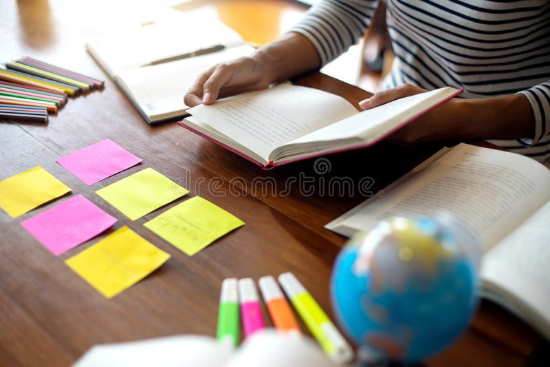 Woman and man work for education or business on the table. With notebook laptop and paper work color pen, in the libary room royalty free stock photos