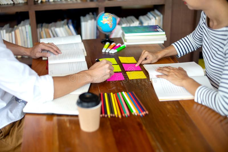 Woman and man work for education or business on the table. With notebook laptop and paper work color pen, in the libary room royalty free stock photo