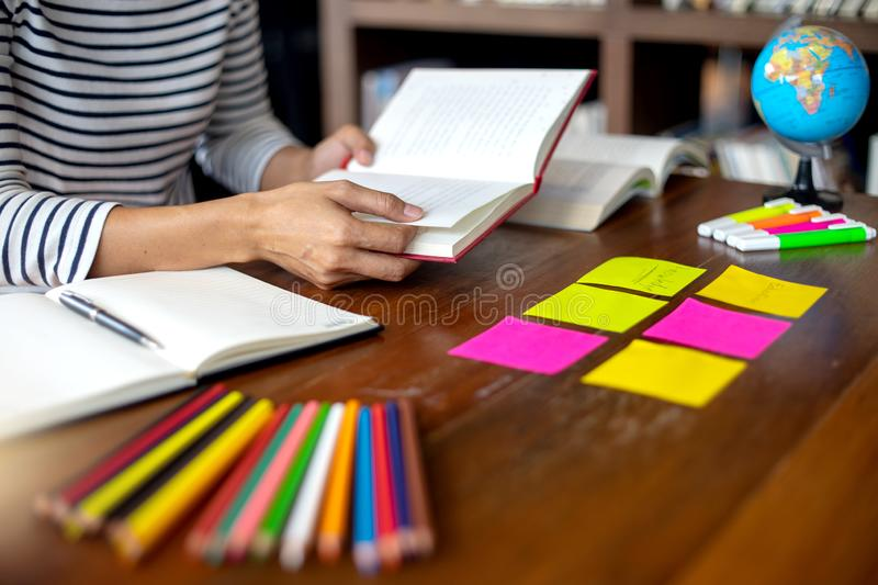 Woman and man work for education or business on the table. With notebook laptop and paper work color pen, in the libary room royalty free stock photography