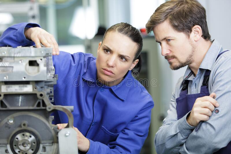 Woman and man working in factory stock photo