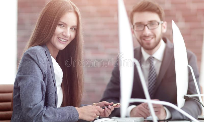 Woman Manager communicates with the client. Manager communicates with the client at your Desk stock photos