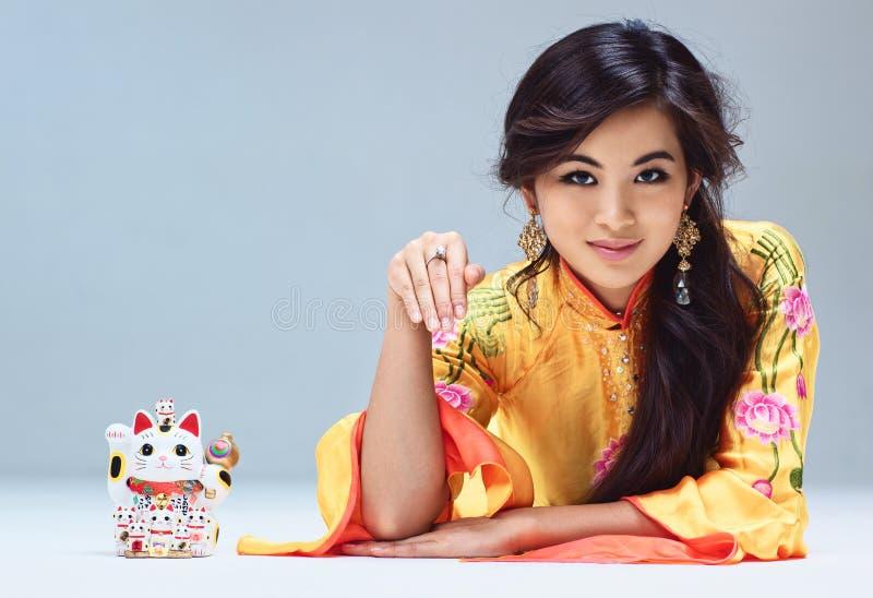 Download Woman with maneki neko cat stock image. Image of asian - 27683151