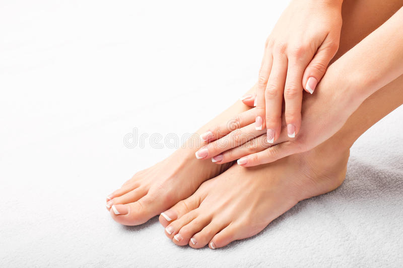 Woman after manicure and pedicure royalty free stock image