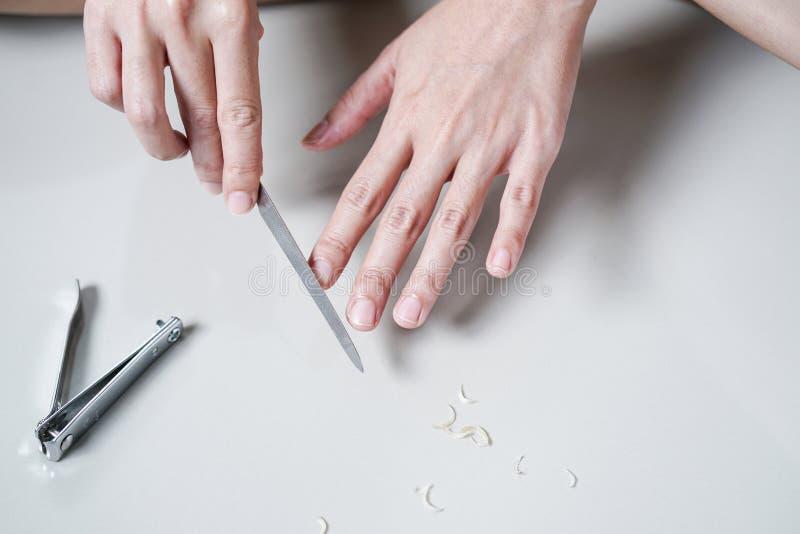 Woman Manicures Files Fingernails stock image