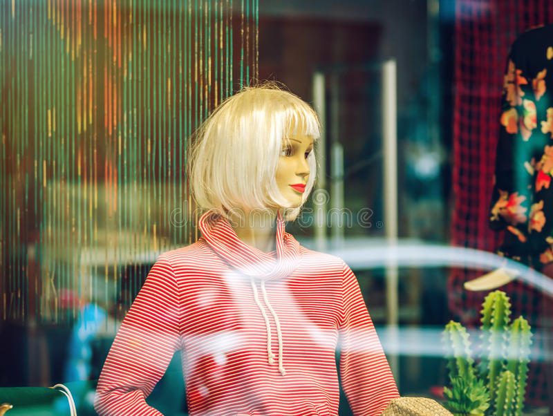 Woman mannequin inside the shop, view through the window royalty free stock photos