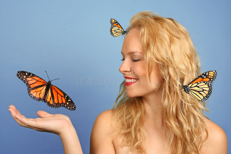 Woman With Many Butterflies in Hand and Her Hair stock images