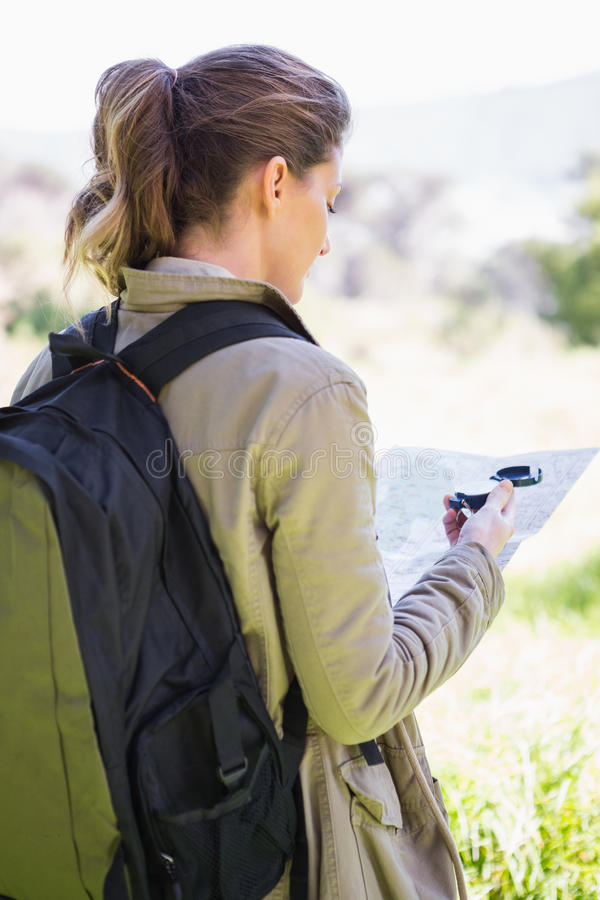 Woman with map and compass stock images