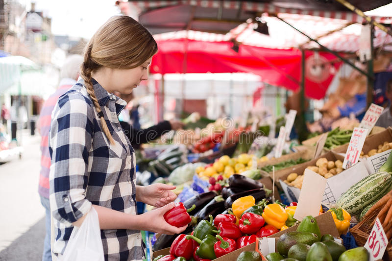 Woman at market royalty free stock image
