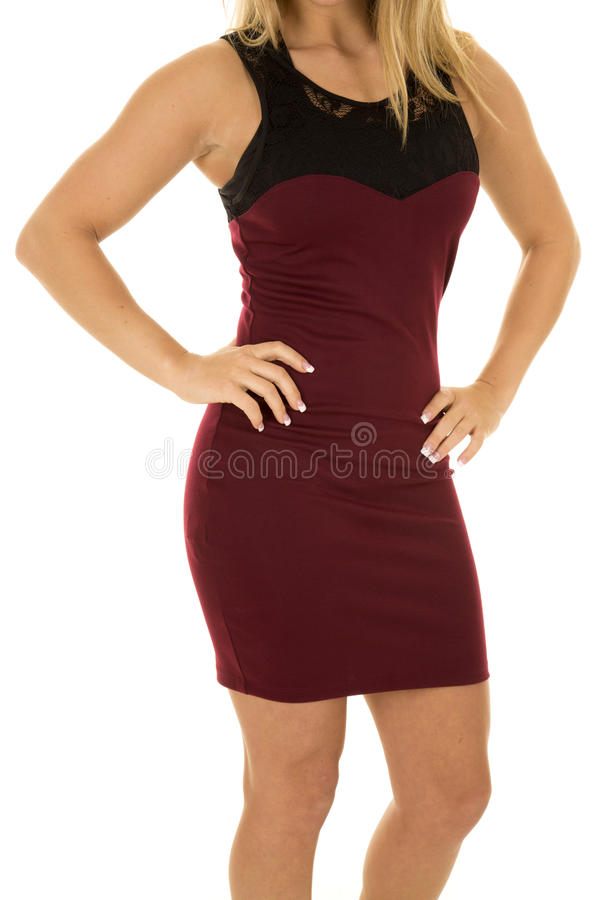 Woman in maroon dress body. A woman in her maroon dress with her hands on her hips stock images