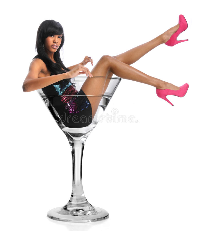 Woman In Martini Glass. African American woman in martini glass isolated over white background stock photo