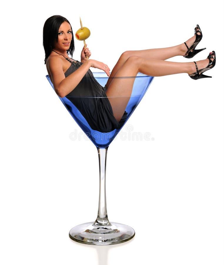 WOman in Martini Glass. Portrait of beautiful woman in martini glass isolated over white background stock photo