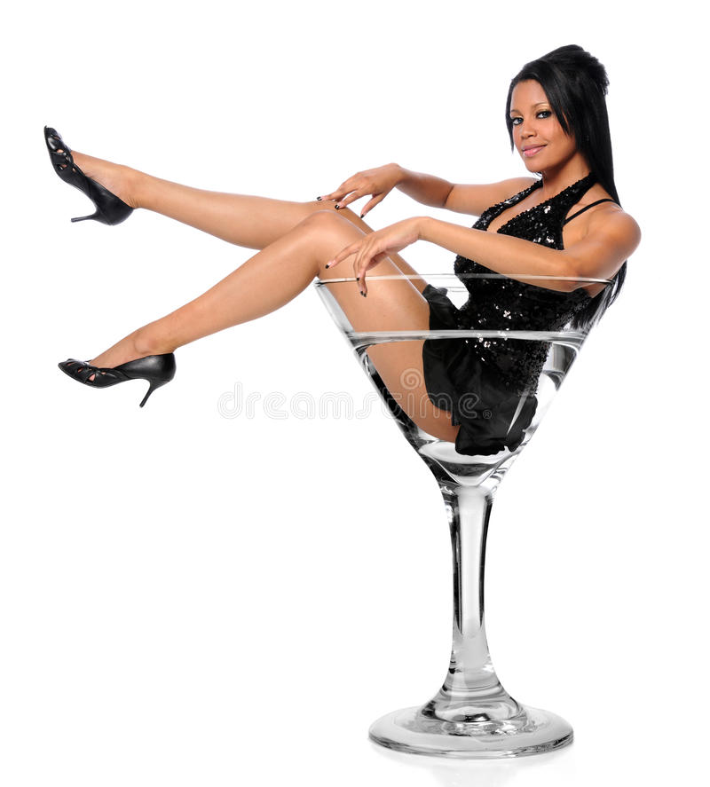 Woman In Martini Glass. Beautiful African American woman sitting in martini glass royalty free stock images