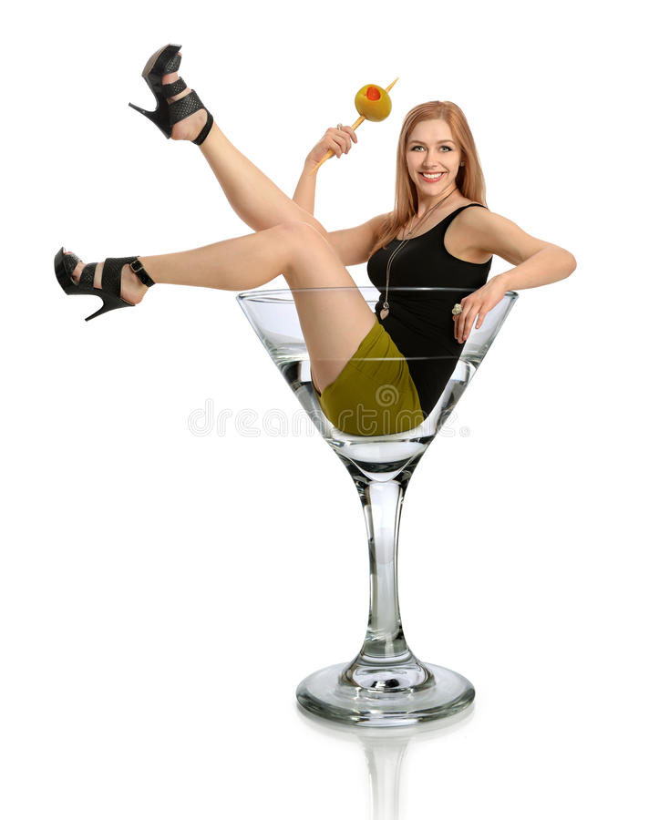 Woman in Martini Glass. Woman holding olive in martini glass isolated over white background royalty free stock images