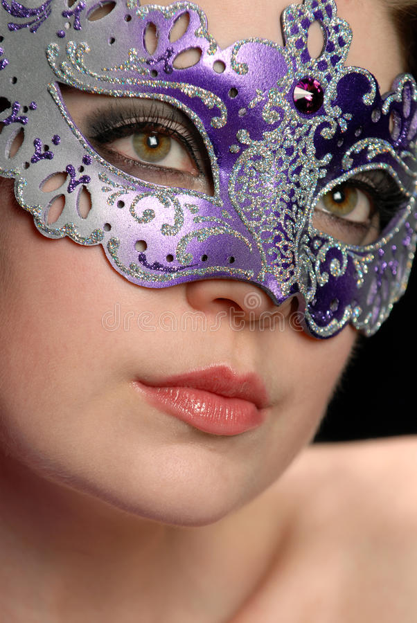 Woman in mask. Headshot of a beautiful woman in a mask royalty free stock photo