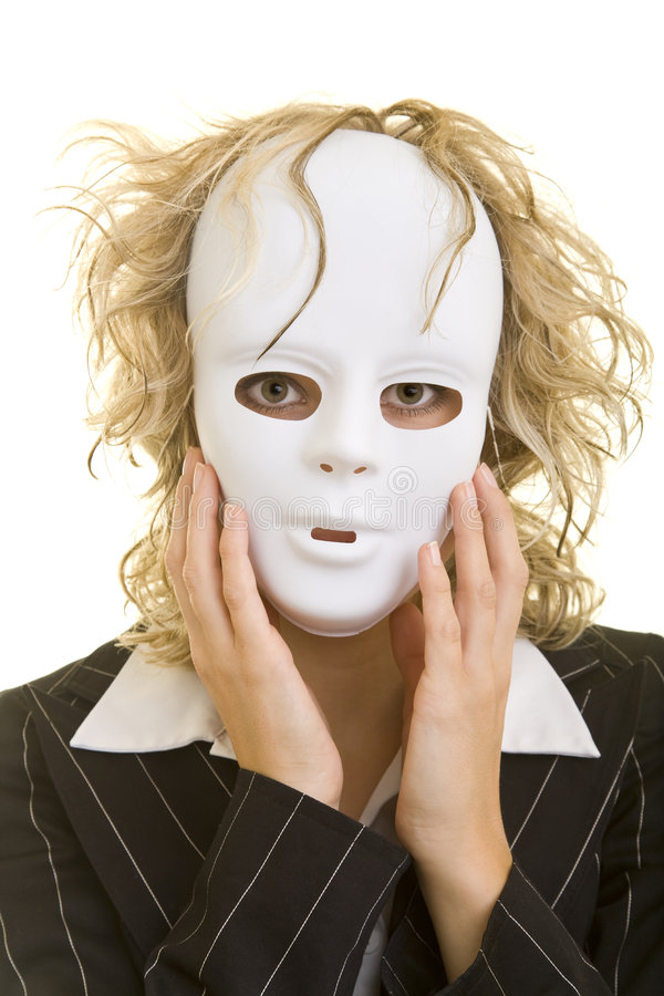 Woman with mask. Blonde business woman holding a white mask in front of her face royalty free stock photos