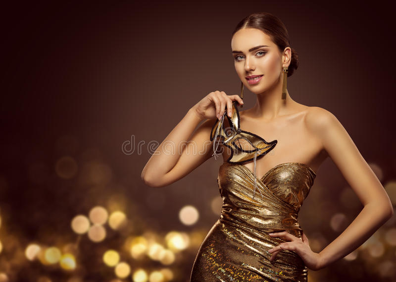 Woman Mask, Fashion Model Face with Golden Carnival Mask, Beauty. Gold Dress stock photography