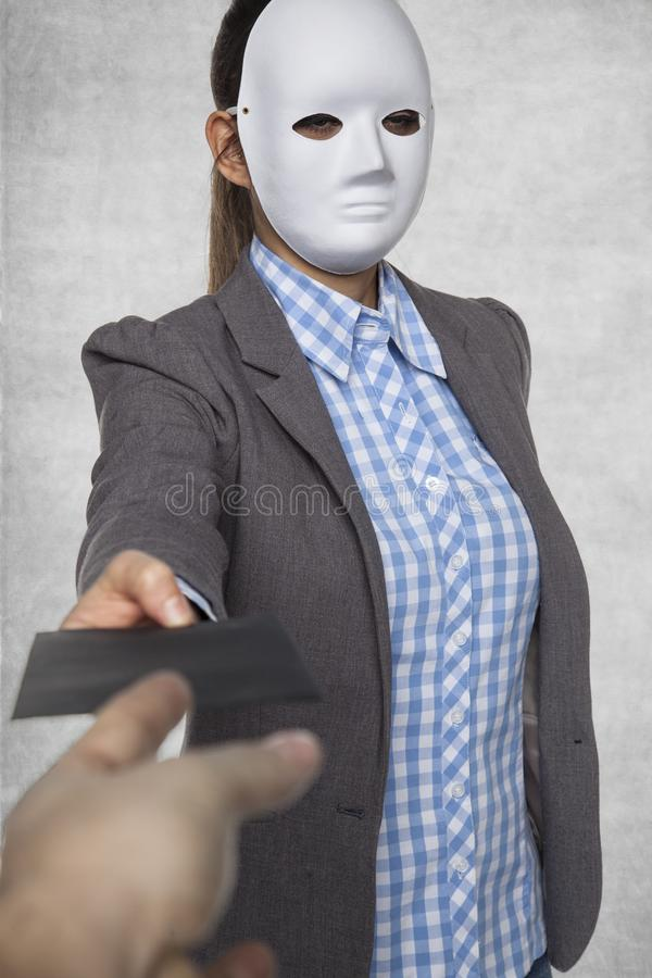 A woman in a mask gives an envelope. Isolated on background stock photo