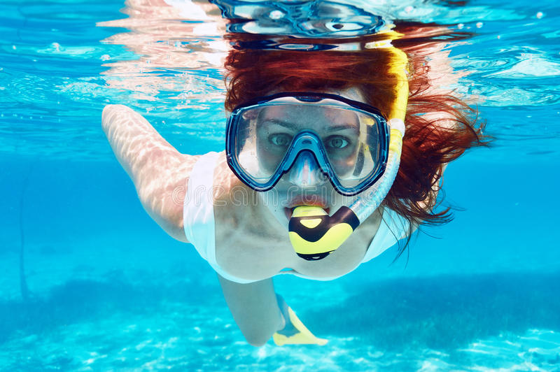 Woman with mask snorkeling stock photography
