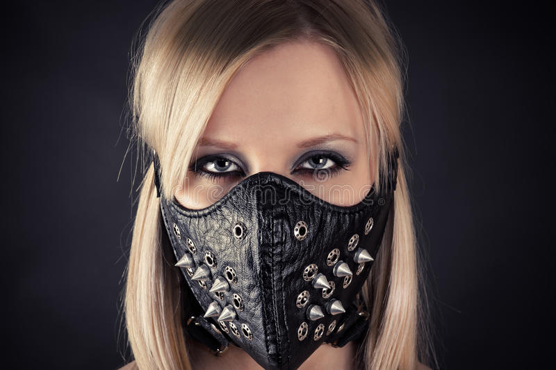 Woman in a mask with spikes stock photo