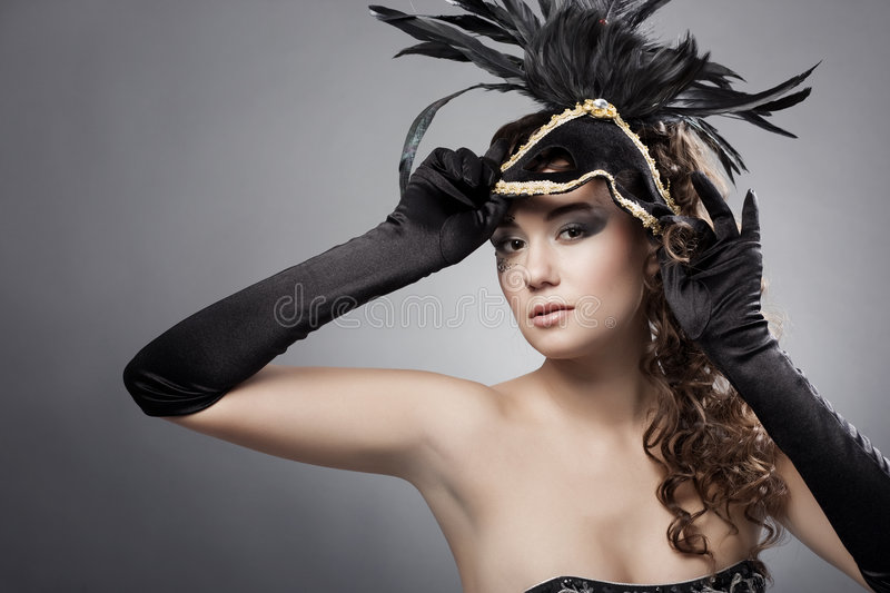 Woman with masquerade mask royalty free stock image