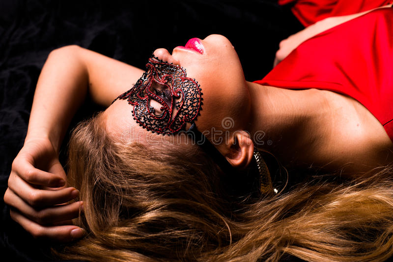 Woman with a masqurade mask stock photo