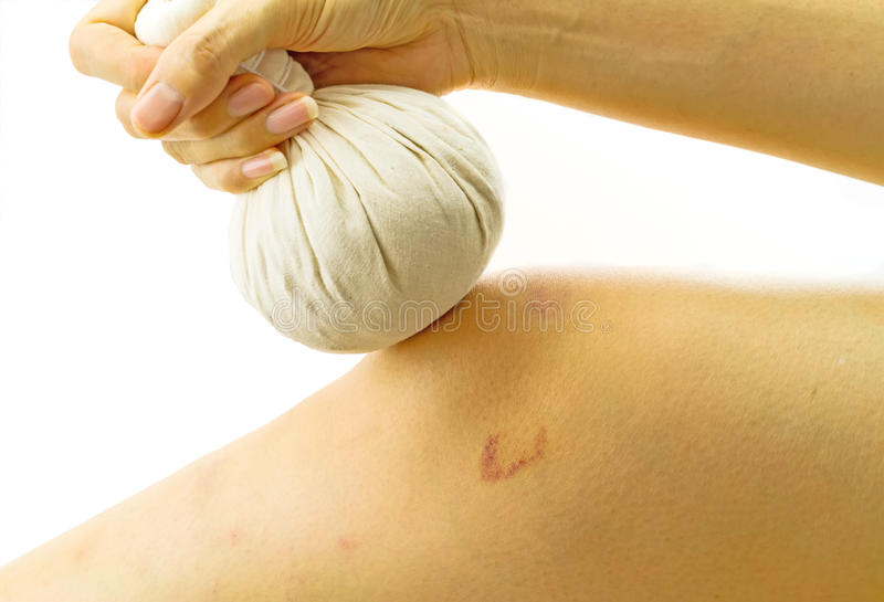Woman massage with herbal compress balls her knee stock photography