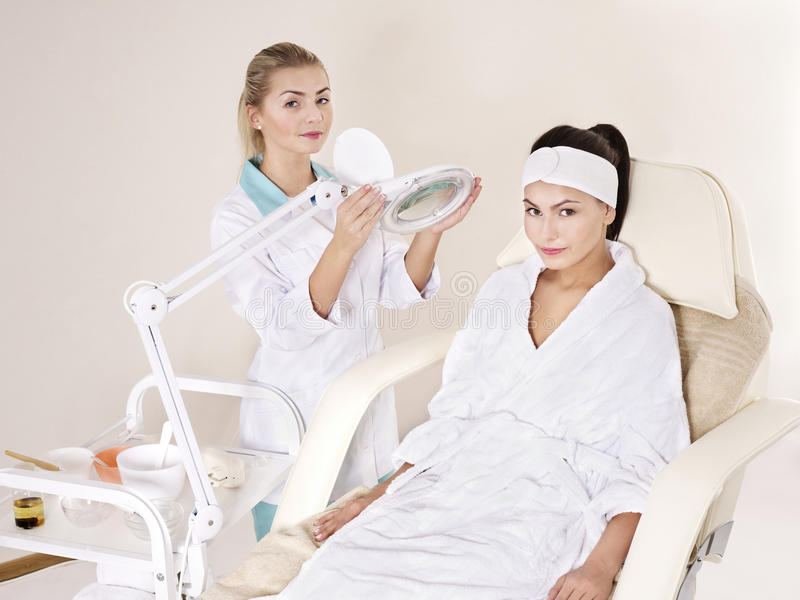 Woman on massage table in beauty spa. stock image