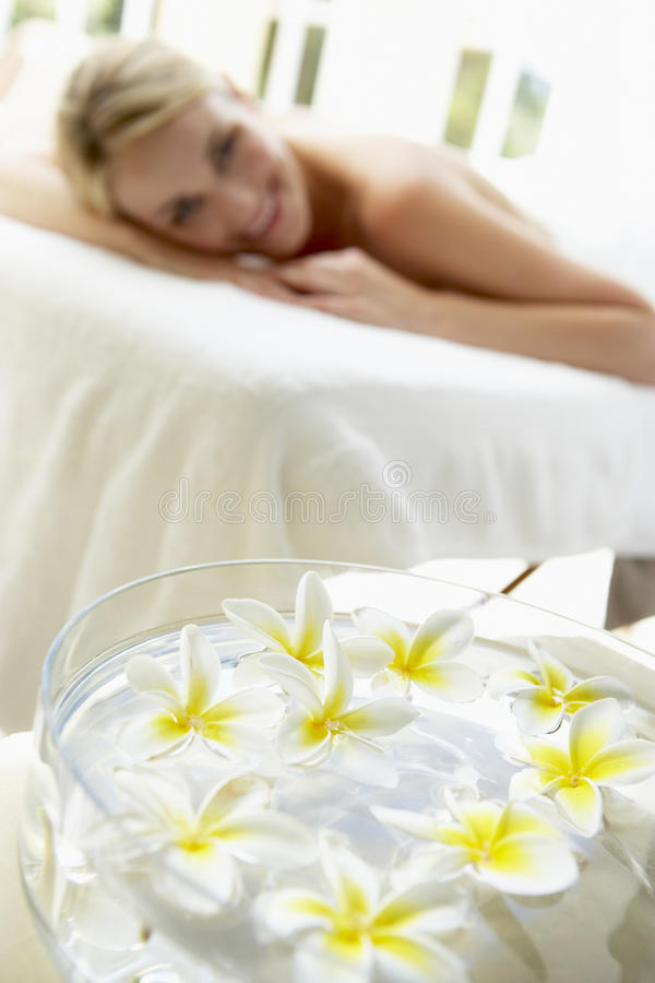 Download Woman On Massage Table With Flowers In Foreground Stock Image - Image: 9388501