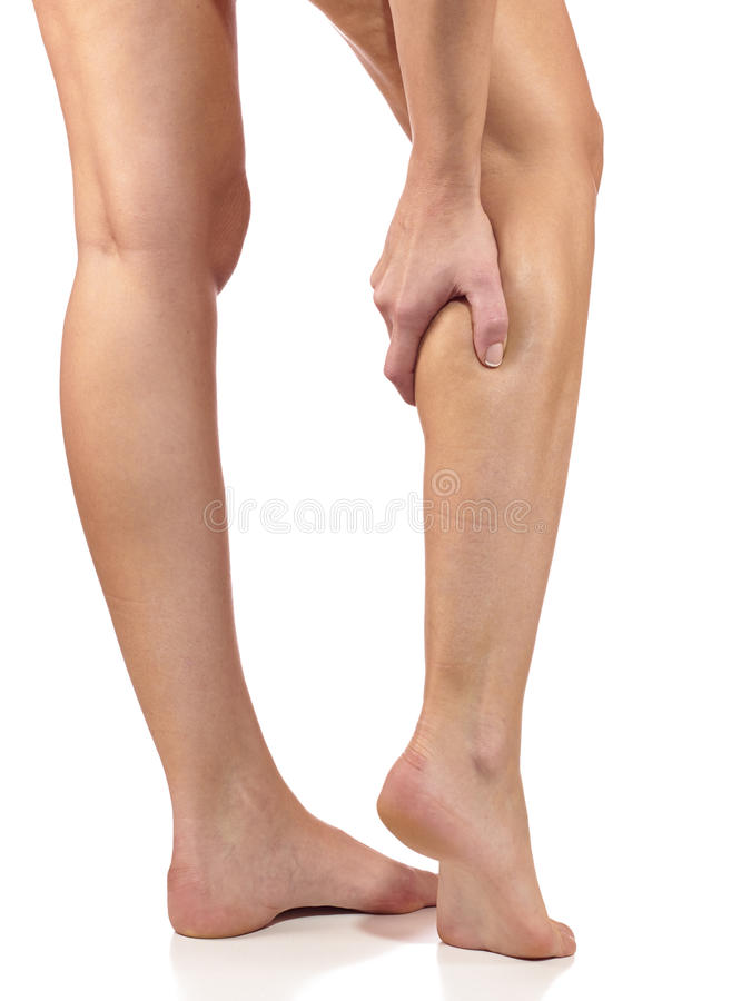Woman massaging her painful leg calf. royalty free stock images