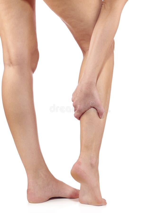 Woman massaging her painful leg calf. stock photography