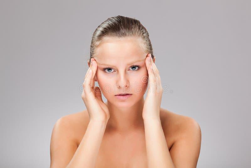 Woman massaging pain head stock photography
