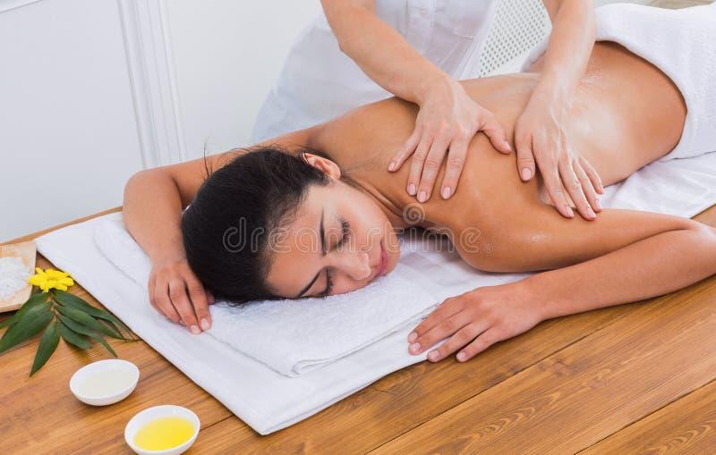 Woman massagist make body massage in spa wellness center royalty free stock images