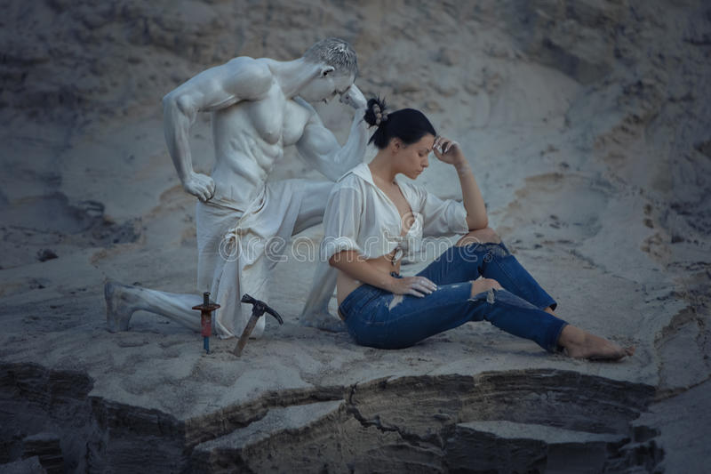 Woman master thoughtful. Sculptor& x27;s wife was thinking during the creation of her own sculpture stock image