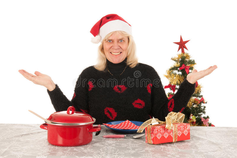 Woman of mature age happy alone with Christmas stock photos