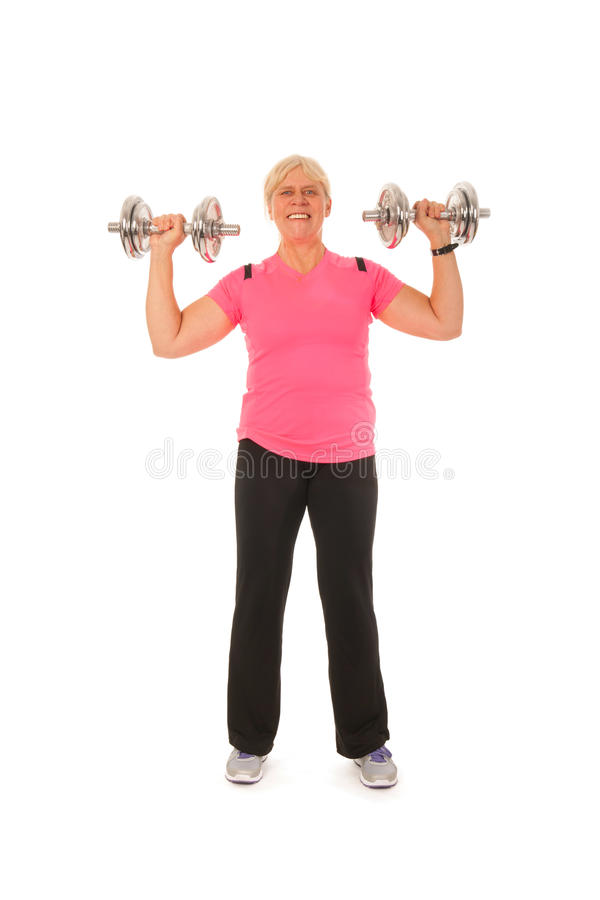 Woman Of Mature Age Lifting Dumbbels Royalty Free Stock Image