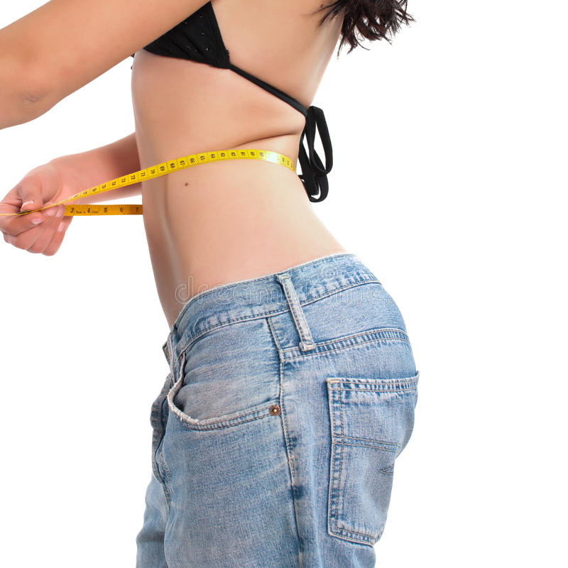 Woman measure her waist belly stock photography