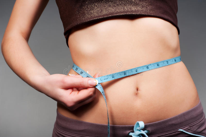 Woman measurement from her waist stock photo