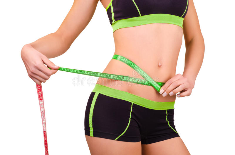 Woman measures the abdominal circumference centimeter tape royalty free stock photo