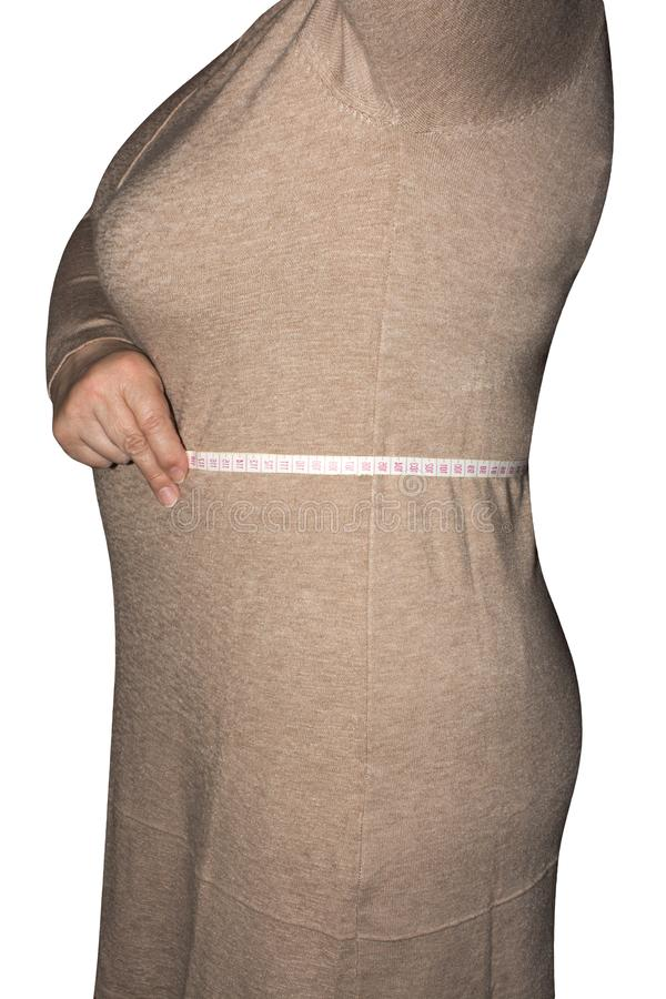 Woman measures waist size. stock photography