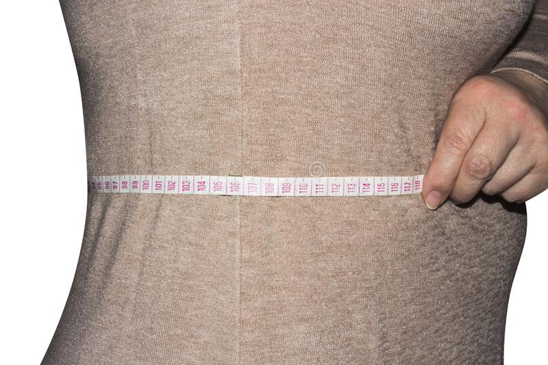Woman measures waist size. royalty free stock photography