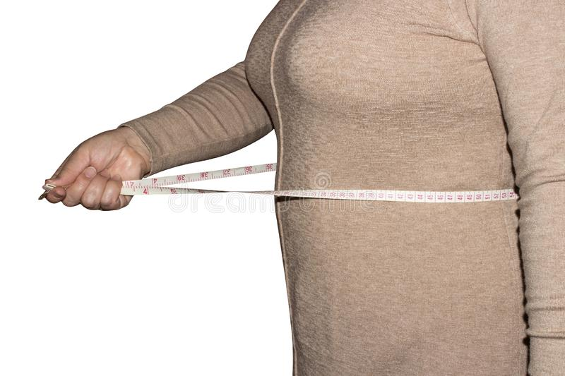 Woman measures waist size. stock photo