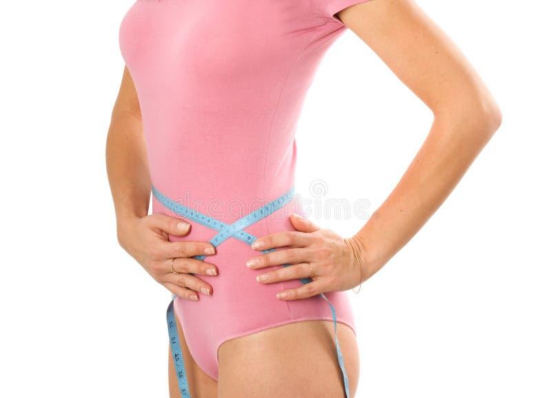 Woman measurin her body size stock photo