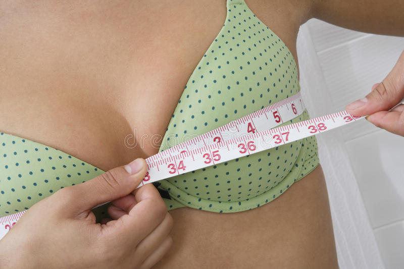 Woman Measuring Breasts royalty free stock photography