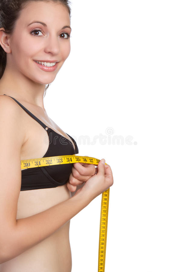 Woman Measuring Bust. Beautiful young woman measuring bust stock photos