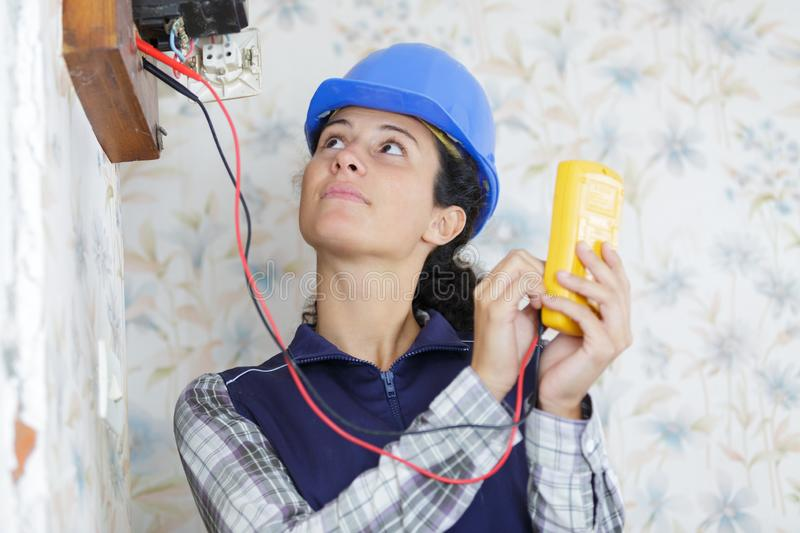 Woman measuring electrical current royalty free stock images